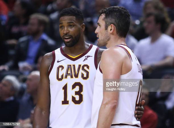 Tristan Thompson of the Cleveland Cavaliers talks to Kevin Love during the second half of the NBA season opener against the Toronto Raptors at...
