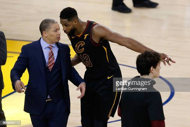 Tristan Thompson of the Cleveland Cavaliers talks with head coach Tyronn Lue during the first half against the Golden State Warriors in Game 1 of the...