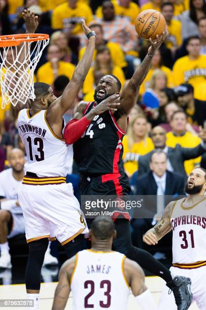 Tristan Thompson of the Cleveland Cavaliers tries to block Patrick Patterson of the Toronto Raptors during the second half of Game One of the NBA...