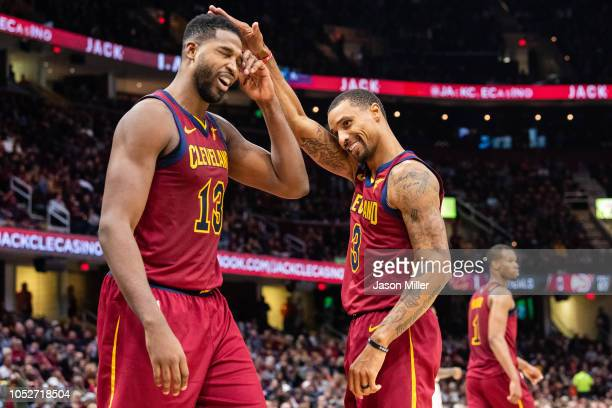 Tristan Thompson reacts as George Hill of the Cleveland Cavaliers teases him after Thompson made a mistake that lead to an Atlanta Hawks basket...