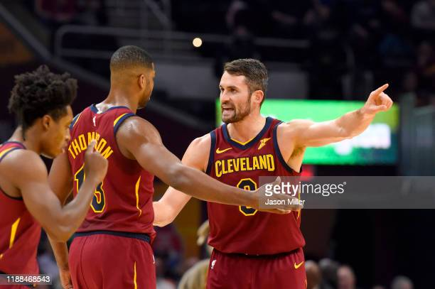 Tristan Thompson talks with Kevin Love of the Cleveland Cavaliers during the first half against the Philadelphia 76ers at Rocket Mortgage Fieldhouse...