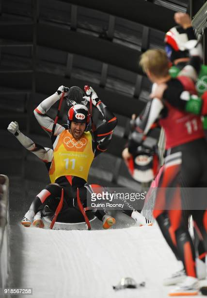 Tristan Walker and Justin Snith of Canada celebrate as they finish their run during the Luge Team Relay on day six of the PyeongChang 2018 Winter...