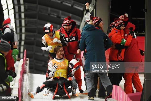 Tristan Walker and Justin Snith of Canada celebrate with team mates after their run during the Luge Team Relay on day six of the PyeongChang 2018...