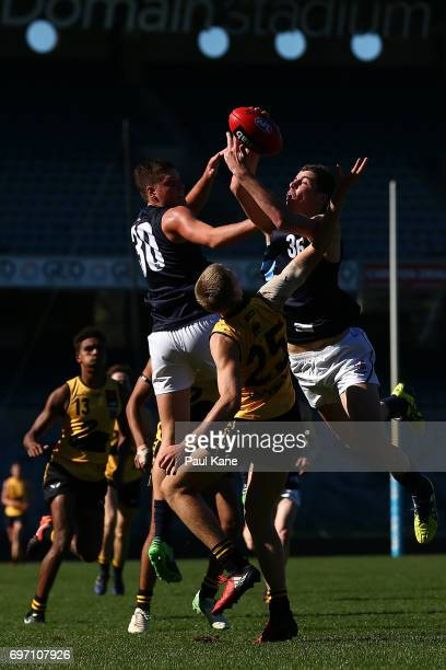 Tristan Xerri of Vic Metro marks the ball during the U18 Championships match between Western Australia and Victoria Metro at Domain Stadium on June...