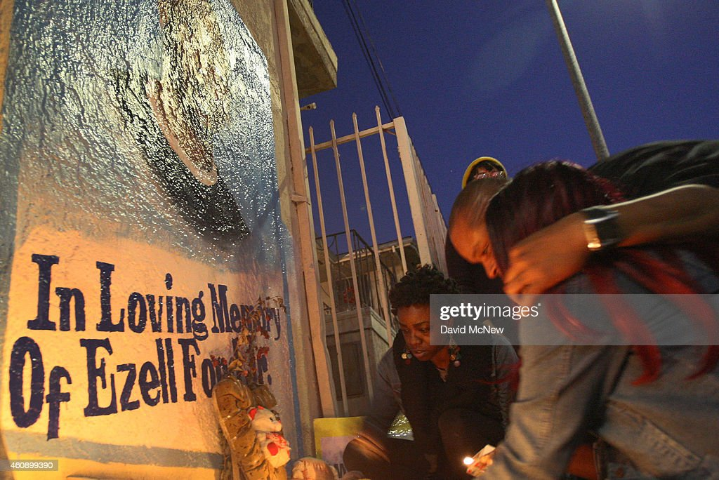 Tritobia Ford (R) is hugged as she and loved ones light candles at a memorial for her son, Ezell Ford, a 25-year-old mentally ill black man, at the site where he was shot and killed by two LAPD officers in August, on December 29, 2014 in Los Angeles, California. The long-awaited autopsy report, which was put on a security hold at the request of police and ordered by L.A. mayor Eric Garcetti to be made public before the end of 2014, was released December 29.