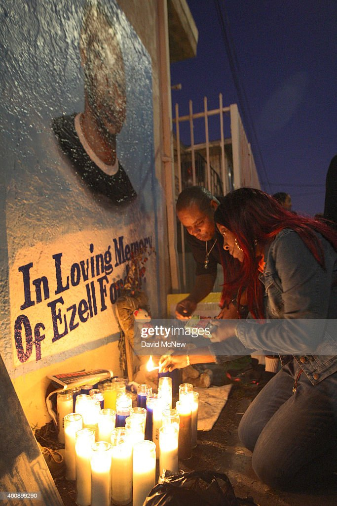 Tritobia Ford (R) lights candles at a memorial for her son, Ezell Ford, a 25-year-old mentally ill black man, at the site where he was shot and killed by two LAPD officers in August, on December 29, 2014 in Los Angeles, California. The long-awaited autopsy report, which was put on a security hold at the request of police and ordered by L.A. Mayor Eric Garcetti to be made public before the end of 2014, was released December 29.