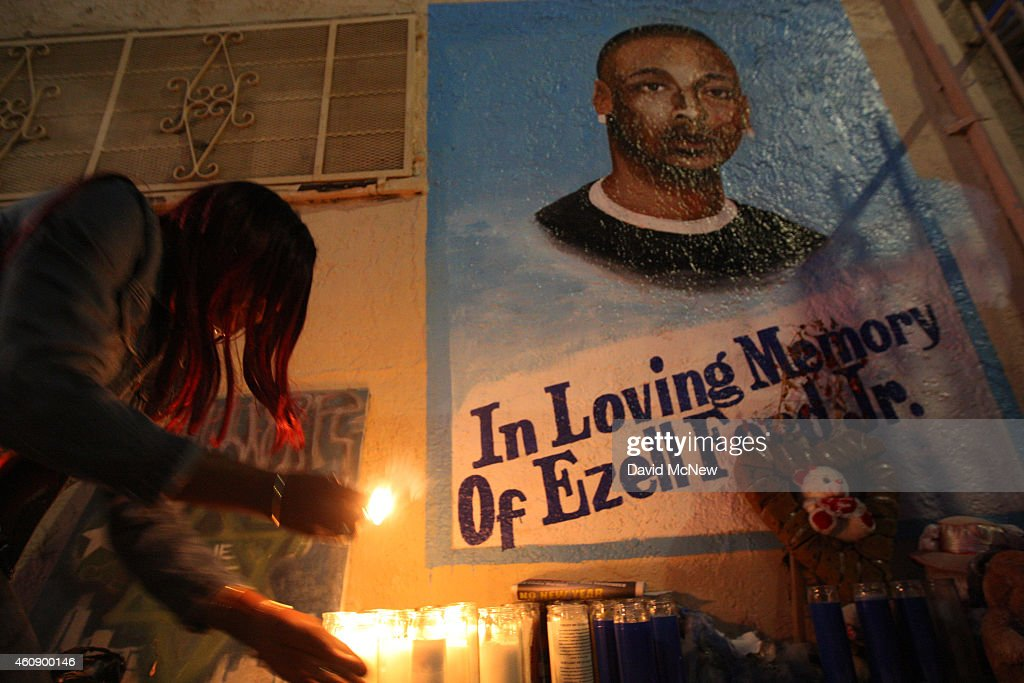 Tritobia Ford lights candles at a memorial for her son, Ezell Ford, a 25-year-old mentally ill black man, at the site where he was shot and killed by two LAPD officers in August, on December 29, 2014 in Los Angeles, California. The long-awaited autopsy report, which was put on a security hold at the request of police and ordered by L.A. Mayor Eric Garcetti to be made public before the end of 2014, was released December 29.