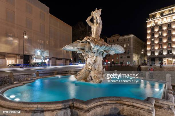 triton fountain is located in rome in piazza barberini. it is the work of gian lorenzo bernini. - lord bath stock pictures, royalty-free photos & images