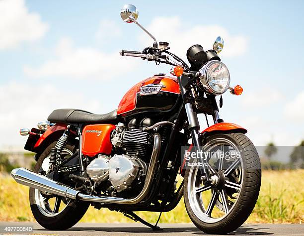 Triumph Bonneville 2012 model retro-styled motorbike on country road