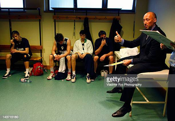 Triumph head coach Vasiliy Karasev gives instructions during the half time of the FIBA Europe EuroChallenge Final Four third place game between...