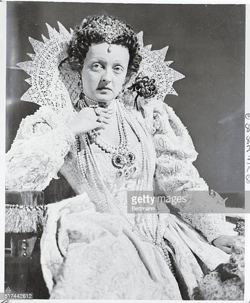 A triumph of the makeup man's art is Bette Davis Warner Bros star pictured here all ready to go before the cameras to portray Queen Elizabeth in The...