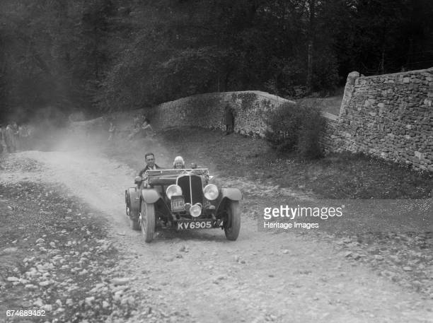 Triumph open tourer competing in a motoring trial, Nailsworth Ladder, Gloucestershire, 1930s.. Artist: Bill Brunell.
