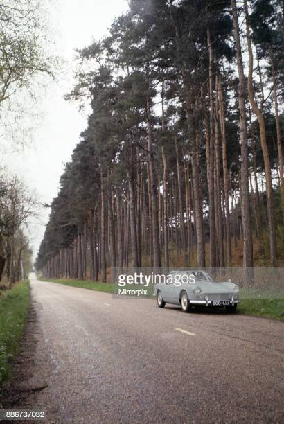 A Triumph Spitfire on a woodland road at Seale in Surrey April 1964