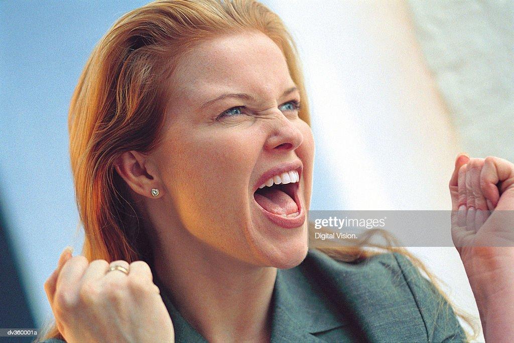 Triumphant businesswoman : Stock Photo