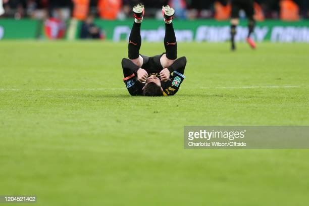 A triumphant Phil Foden of Man City collapses at the final whistle during the Carabao Cup Final between Aston Villa and Manchester City at Wembley...