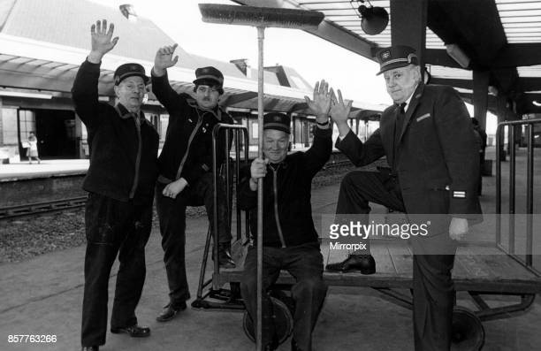 Triumphant wave from staff of Middlesbrough Station after they have heard they have won the tidiest North-East station, left to right, Stan Caswell,...