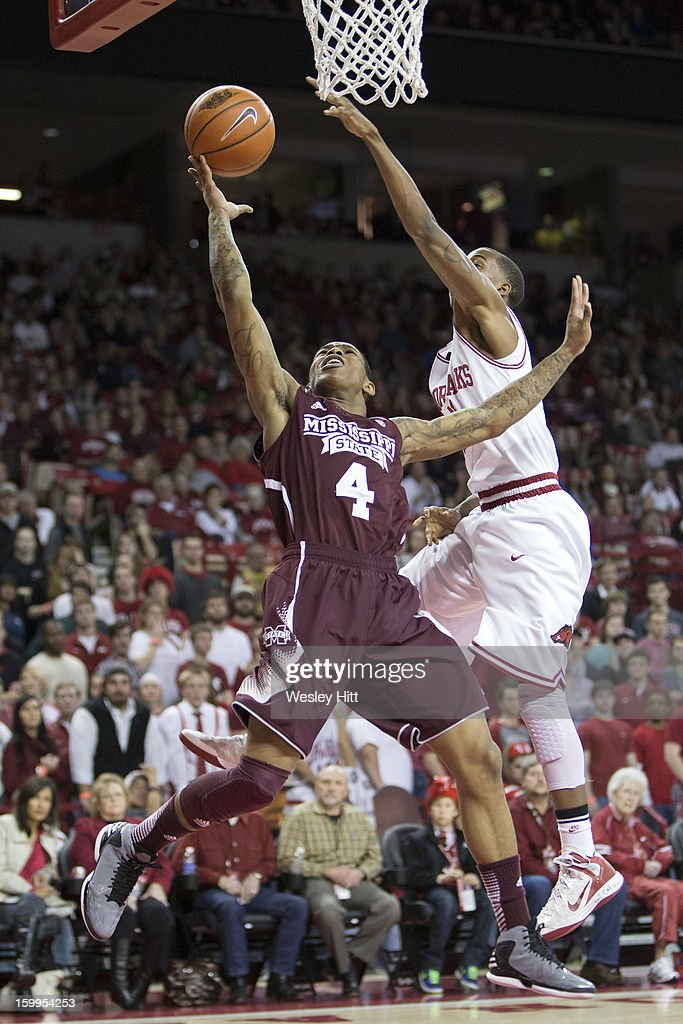 Trivante Bloodman #4 of the MIssissippi State Bulldogs goes up for a layup past BJ Young #23 of the Arkansas Razorbacks at Bud Walton Arena on January 23, 2013 in Fayetteville, Arkansas. The Razorbacks defeated the Bulldogs 96-70.