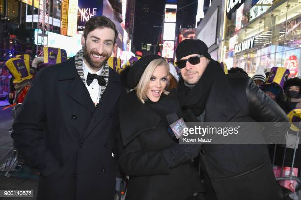 Trivia Host Scott Rogowsky Jenny McCarthy and Donnie Wahlberg pose at the Dick Clark's New Year's Rockin' Eve with Ryan Seacrest 2018 on December 31...