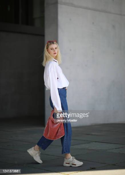 Trixi Giese wearing Levis Jeans, Gucci sneaker, Samsoe Samsoe bag and vintage flanell on May 26, 2020 in Berlin, Germany.