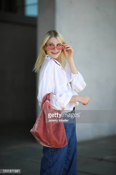 Trixi Giese wearing Levis Jeans, Samsoe Samsoe bag and vintage flanell on May 26, 2020 in Berlin, Germany.
