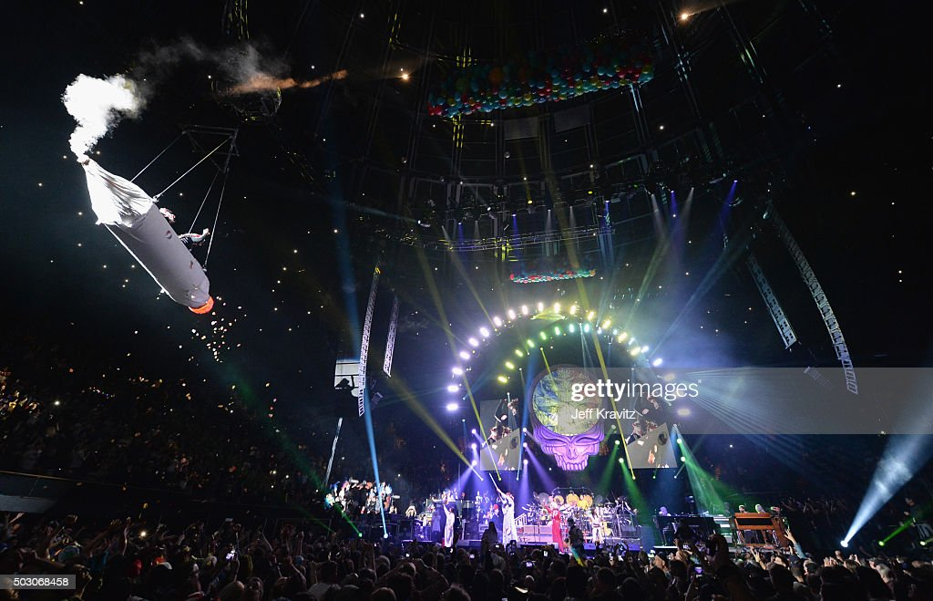Trixie Garcia and Bernie Cahill ride a joint during the Dead and Company performance at The Forum on December 31, 2015 in Inglewood, California.