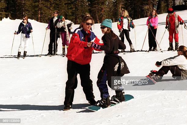 TRMammoth#2AS2–12–96A Mammoth Lakes CA Mammoth Mountain Snowboarder Instructor Jessica Rosen instructing Ashley Troncatti from Agoura in a beginner...