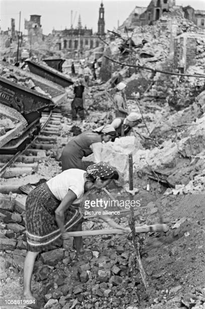 Trümmerfrauen work on a rubbish heap next to the Trümmerbahn in the old city of Dresden Germany unknown date Photo Deutsche Fotothek / Richard Peter...