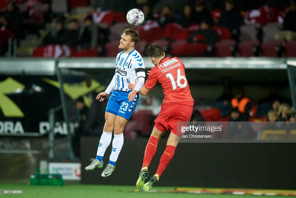 Troels Klove of OB Odense and Benjamin Hansen of FC Nordsjalland heading the ball during the Danish Alka Superliga match between FC Nordsjalland and OB Odense at Right to Dream Park on February 16, 2018 in Farum, Denmark.