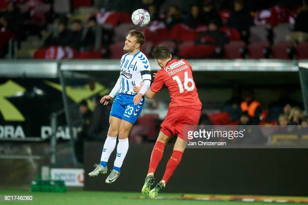 Troels Klove of OB Odense and Benjamin Hansen of FC Nordsjalland heading the ball during the Danish Alka Superliga match between FC Nordsjalland and...