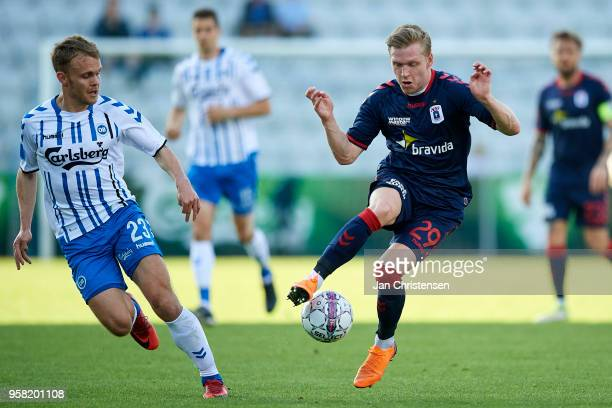 Troels Klove of OB Odense and Bror Blume of AGF Arhus compete for the ball during the Danish Alka Superliga match between OB Odense and AGF Arhus at...