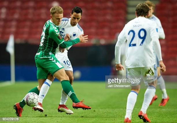 Troels Klove of OB Odense and Carlos Zeca of FC Copenhagen compete for the ball during the Danish Alka Superliga match between FC Copenhagen and OB...