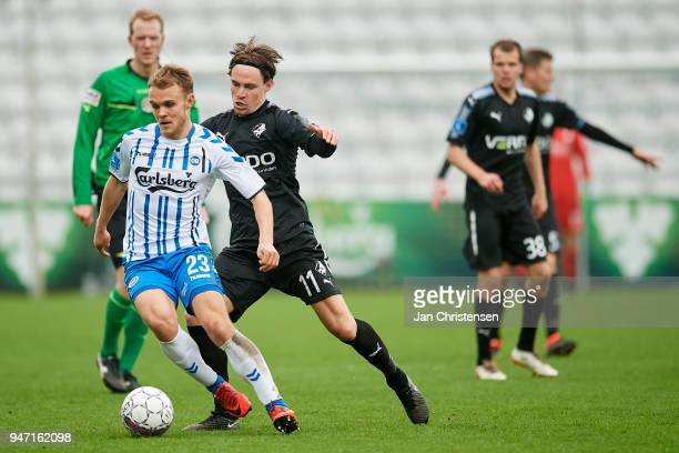 Troels Klove of OB Odense and Erik Marxen of Randers FC compete for the ball during the Danish Alka Superliga match between OB Odense and Randers FC...