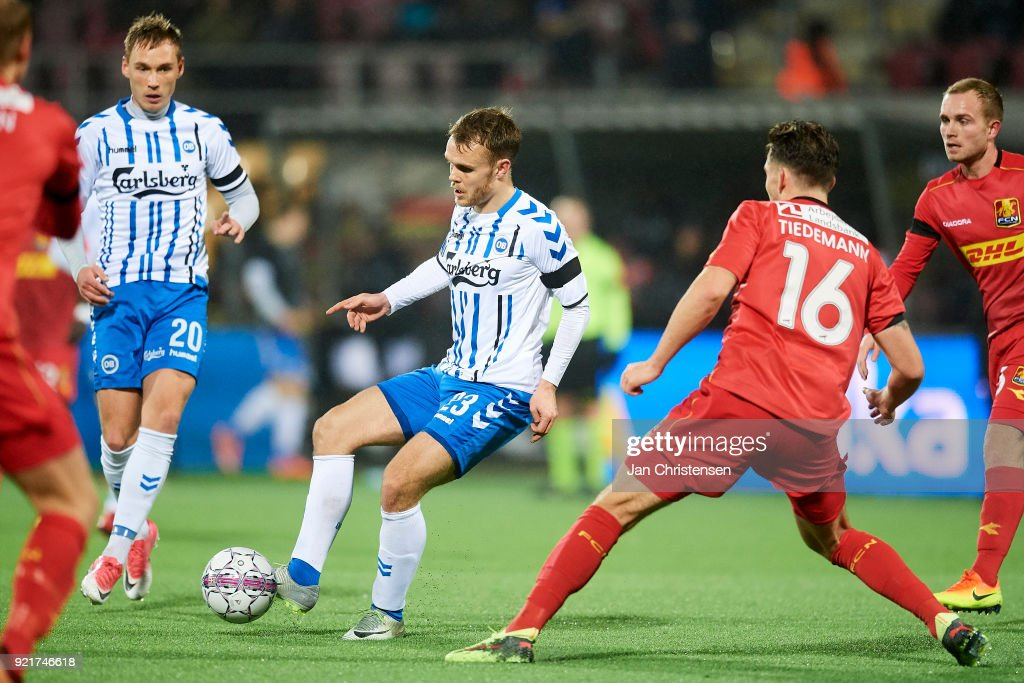 Troels Klove of OB Odense compete for the ball during the Danish Alka Superliga match between FC Nordsjalland and OB Odense at Right to Dream Park on February 16, 2018 in Farum, Denmark.