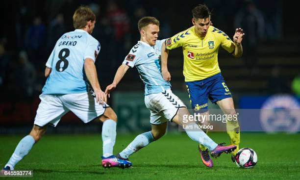 Troels Klove of Sonderjyske and Gregor Sikosek of Brondby IF compete for the ball during the Danish Alka Superliga match match between Sonderjyske...
