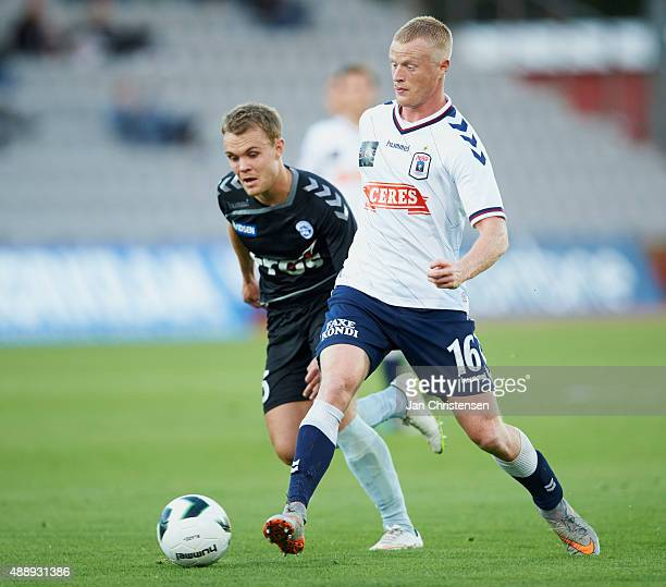 Troels Klove of SonderjyskE and Jens Jonsson of AGF Arhus compete for the ball during the Danish Alka Superliga match between AGF Arhus and...