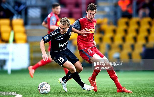 Troels Klove of Sonderjyske and Mathias Hebo of FC Nordsjalland compete for the ball during the Danish Alka Superliga match between FC Nordsjalland...