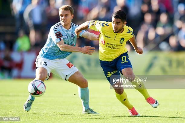 Troels Klove of SonderjyskE and Rezan Corlu of Brondby IF compete for the ball during the Danish Alka Superliga match between SonderjyskE and Brondby...