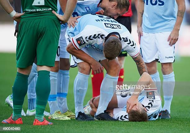 Troels Klove of SonderjyskE gets injuried during the Danish Alka Superliga match between SonderjyskE and OB Odense at Sydbank Park on September 25...