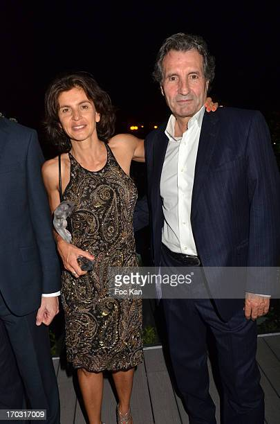 Trofemina 2013 awarded reporter Anne Nivat and her husband TV journalist Jean Jacques Bourdin attend the Trofemina Edition 2013 By Tentation at the...
