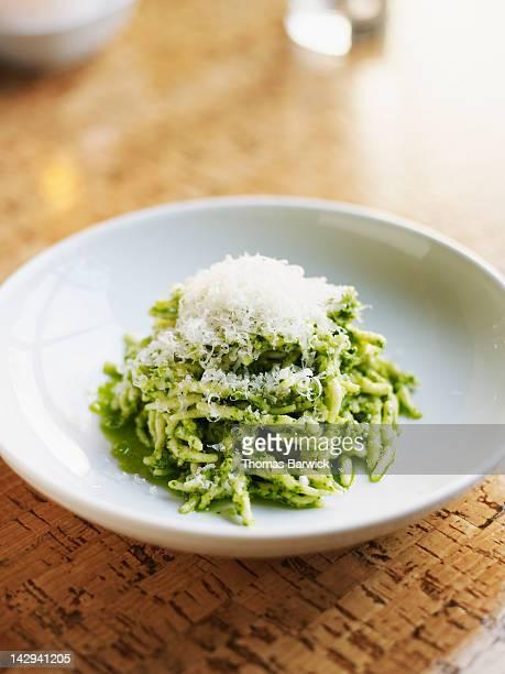trofie pasta with parsley walnut pesto - pesto stock pictures, royalty-free photos & images