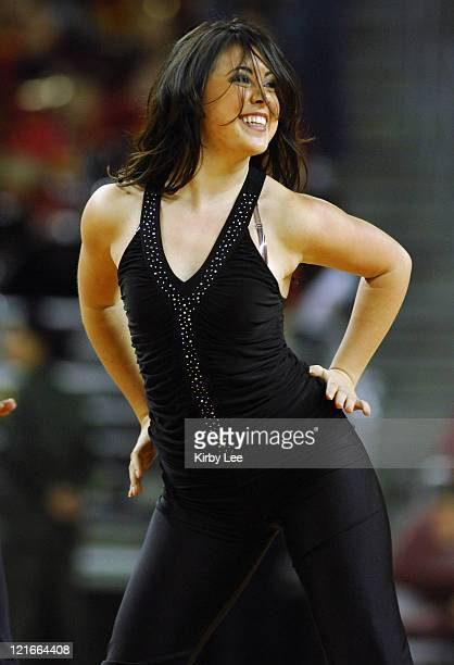 Trojan Force Dance Team cheerleader performs during Pacific10 Conference basketball game against Arizona State at the Galen Center in Los Angeles...