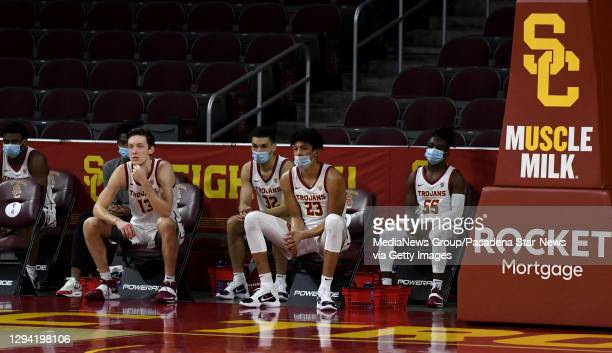 Trojans bench looks on against the Utah Utes In the first half of a NCAA basketball game at Galen Center on the campus of the University of Southern...