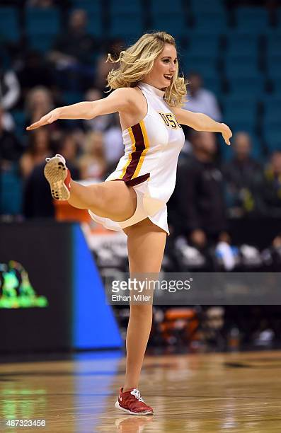 Trojans cheerleader performs during a firstround game of the Pac12 Basketball Tournament against the Arizona State Sun Devils at the MGM Grand Garden...