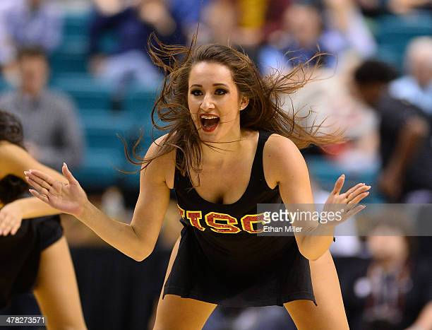 Trojans cheerleader performs during a firstround game of the Pac12 Basketball Tournament against the Colorado Buffaloes at the MGM Grand Garden Arena...