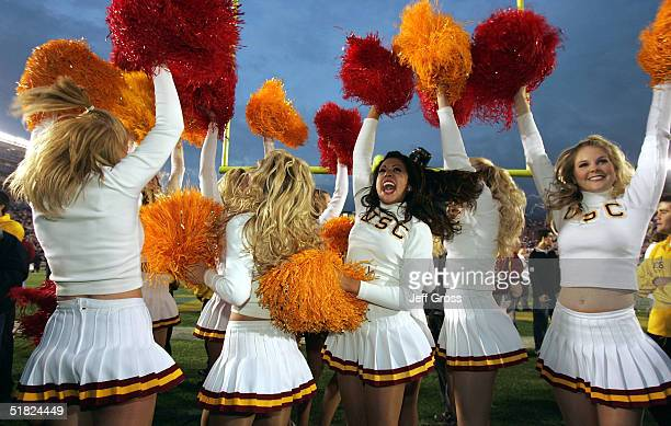 Trojans cheerleaders celebrate the team's 29-24 victory over the UCLA Bruins on December 4, 2004 at the Rose Bowl in Pasadena, California