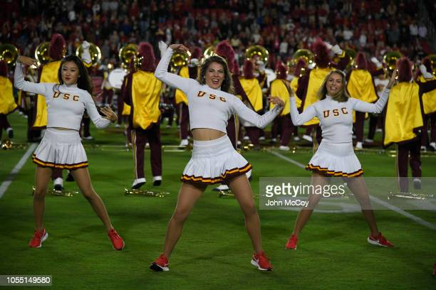 Trojans cheerleaders dance with the Trojan Marching band at Los Angeles Memorial Coliseum on October 13 2018 in Los Angeles California