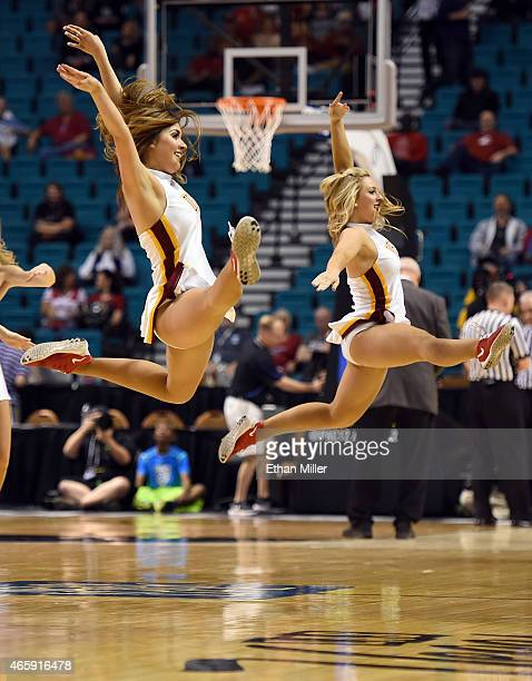 Trojans cheerleaders perform during a firstround game of the Pac12 Basketball Tournament against the Arizona State Sun Devils at the MGM Grand Garden...
