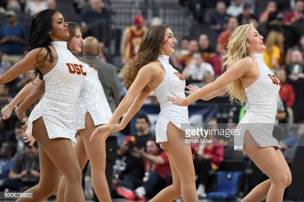 Trojans cheerleaders perform during the championship game of the Pac12 basketball tournament between the Trojans and the Arizona Wildcats at TMobile...