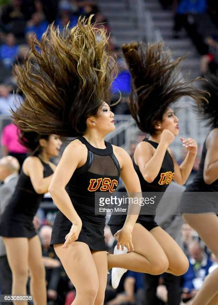 Trojans cheerleaders perform during the team's quarterfinal game of the Pac12 Basketball Tournament against the UCLA Bruins at TMobile Arena on March...