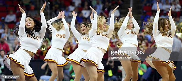 Trojans cheerleaders perform in the game against the Providence Friars during the first round of the 2016 NCAA Men's Basketball Tournament at PNC...